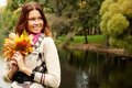 Young woman with autumn leaves in park happy Royalty Free Stock Images