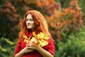 Young woman with autumn leaves in park happy Royalty Free Stock Photos