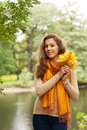 Young woman with autumn leaves in park happy Stock Photo