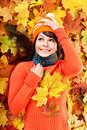 Young woman in autumn orange leaves. Stock Photo