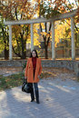 Young woman in autumn park Royalty Free Stock Images