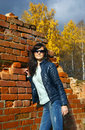 Young woman in autumn season sunny day Stock Photo