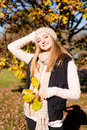 Young woman in autumn sunshine outdoor Stock Images