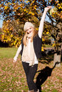 Young woman in autumn sunshine outdoor Stock Photos