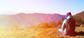 Young woman with backpack travel in mountains panorama Stock Images