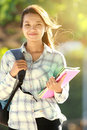 Young woman with bag and books portrait of beautiful holding in campus park Royalty Free Stock Images