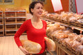 Young woman in bakery Stock Images