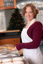 Young woman baking Pizelle Christmas Holiday Stock Photos