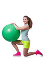 Young woman with ball exercising on white Royalty Free Stock Photo