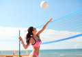 Young woman with ball playing volleyball on beach Royalty Free Stock Photo