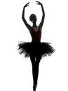 Young woman ballerina ballet dancer dancing one caucasian with tutu in silhouette studio on white background Royalty Free Stock Images