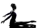 Young woman ballerina ballet dancer stretching Stock Photos