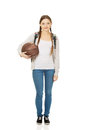 Young woman with basket ball teenager schoolbag and Royalty Free Stock Photography