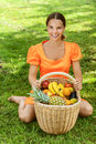 Young woman with baskets of fruit Stock Photography