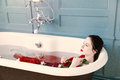 Young woman in bath with flowers Royalty Free Stock Photo