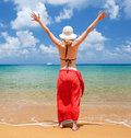 Young woman on the beach with red sarong Royalty Free Stock Photos
