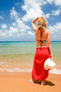 Young woman on the beach with red sarong Royalty Free Stock Photography