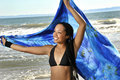 Young woman at beach with sarong overhaed Royalty Free Stock Photo