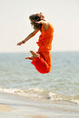 Young woman on the beach in summer dancing Stock Image