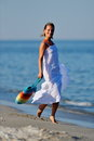 Young woman on the beach in summer happy Royalty Free Stock Photography
