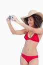Young woman in beachwear photographing herself Royalty Free Stock Photography