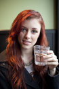 Young Woman with Beautiful Auburn Hair Drinking Water Royalty Free Stock Photo