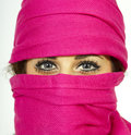 Young woman with beautiful eyes wearing scarf a wears a warm pink accentuating her blue in the cold winter weather Royalty Free Stock Photo
