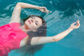 Young woman beauty portrait attractive swimming on a spa s pool in water Stock Photos