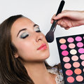 Young woman at beauty salon applying makeup Royalty Free Stock Image