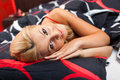 Young woman in bed in red underwear Stock Photo