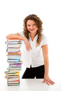 Young woman behind pile of books isolated on white background Royalty Free Stock Photos