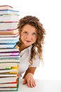 Young woman behind pile of books isolated on white background Stock Photos