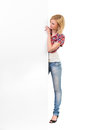 Young woman behind a white banner an attractive blond is standing big and reading full length studio shot isolated on Stock Images