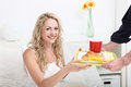 Young woman being treated to breakfast in bed Stock Photos