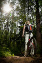 Young woman with bicycle in forest Stock Photography