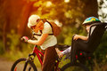 Young woman on a bicycle with little daughter  behind Royalty Free Stock Photo