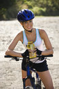 Young woman bicycling. Stock Images