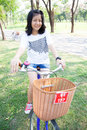 Young woman bicycling within the park the space allocated for in particular Royalty Free Stock Photo