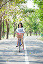 Young woman bicycling within the park the space allocated for in particular Royalty Free Stock Images