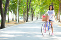 Young woman bicycling. Royalty Free Stock Photo