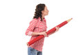 Young woman with big red pencil Royalty Free Stock Photo