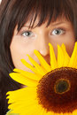 Young woman with a big sun flower Stock Images