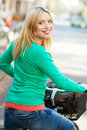 Young woman on bike Stock Images