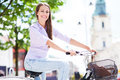 Young woman on bike riding a in the city Stock Images