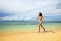Young woman in bikini running on the beach, Taveuni Island, Fiji Royalty Free Stock Photo