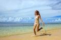 Young woman in bikini running on the beach on Taveuni Island, Fiji Royalty Free Stock Photo