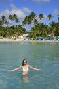 Young woman in bikini standing in clear water boca chica beach dominican republic Royalty Free Stock Photo