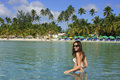 Young woman in bikini standing in clear water boca chica beach dominican republic Royalty Free Stock Photography