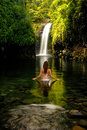 Young woman in bikini standing at Wainibau Waterfall on Taveuni Royalty Free Stock Photo