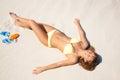 Young Woman In Bikini Sunning ...